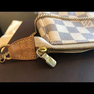 Louis Vuitton Bags - NWT Authentic Louis Vuitton Mini Pochette